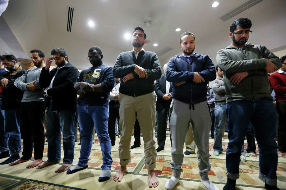 Worshippers offer their prayers for the victims and families of the San Bernardino, Calif., shooting earlier this month at the Islamic Society of Greater Houston. Muslim Americans say they have found themselves called to denounce violence they feel they have nothing to do with. Photo: Steve Gonzales / © 2015 Houston Chronicle