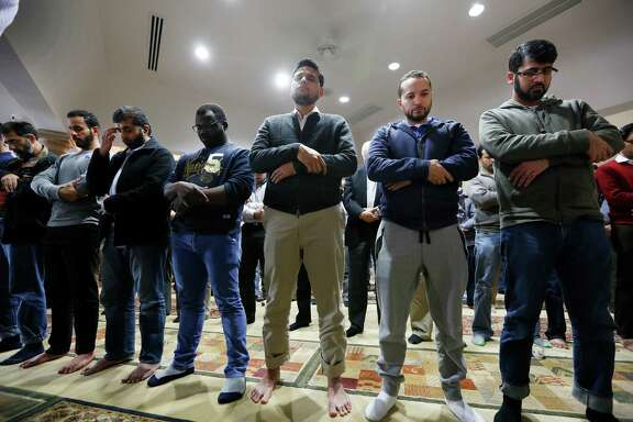Worshippers offer their prayers for the victims and families of the San Bernardino, Calif., shooting earlier this month at the Islamic Society of Greater Houston. Muslim Americans say they have found themselves called to denounce violence they feel they have nothing to do with.