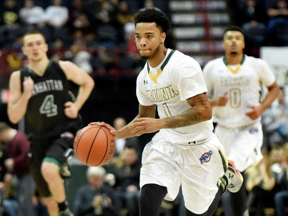 Siena's Marquis Wright, center, drives up court during their basketball game against Manhattan on Friday, Dec. 4, 2015, at Times Union Center in Albany, N.Y. (Cindy Schultz / Times Union)