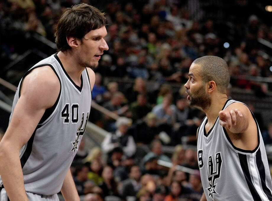 San Antonio Spurs guard Tony Parker, right, of France, talks to Spurs center Boban Marjanovic, of Serbia, during the second half of an NBA basketball game against the Denver Nuggets, Saturday, Dec. 26, 2015, in San Antonio. (AP Photo/Darren Abate) Photo: Darren Abate, FRE / Associated Press / FR115 AP