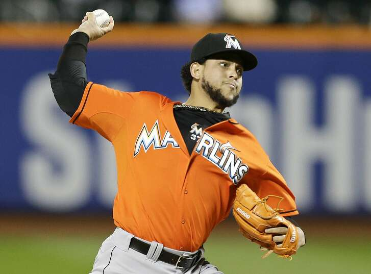 FILE - In this Wednesday, Sept. 17, 2014 file photo, Miami Marlins' Henderson Alvarez delivers a pitch during the first inning of a baseball game against the New York Mets in New York. The Oakland Athletics and pitcher Henderson Alvarez have agreed to a one-year contract. The team announced the move on Monday, Dec. 28, 2015. (AP Photo/Frank Franklin II, File)