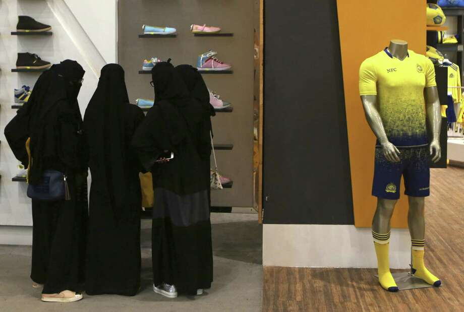 FILE - In this Friday, Dec. 11, 2015 photo, Saudi women shop at a mall in Riyadh, Saudi Arabia. The kingdom has announced on Monday, Dec. 28, 2015 a projected budget deficit in 2016 of $87 billion (327 billion riyals), as lower oil prices cut into the government's main source of revenue.(AP Photo/Khalid Mohammed, File) Photo: Khalid Mohammed, STF / AP