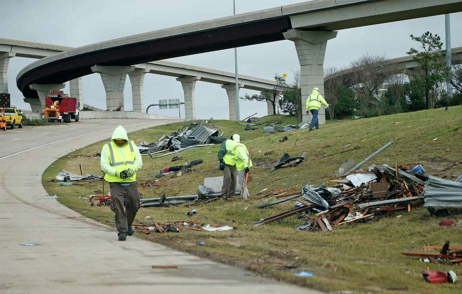 City work crews begin the cleanup near Interstate 30 on Monday after tornadoes ravaged the Garland area over the weekend. Photo: Stewart F. House, Stringer / 2015 Getty Images