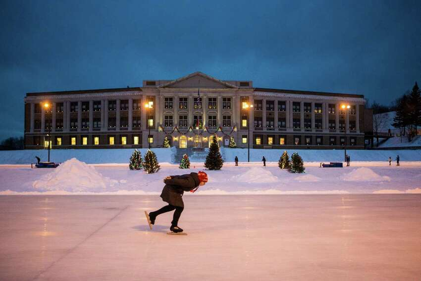 An ice skater on a 400-meter oval track, where American Eric Heiden won 5 Olympic gold medals, in Lake Placid, N.Y., Jan. 10, 2014 In and around the Adirondack village of Lake Placid, which hosted the 1932 and the 1980 Winter Games, event sites there are open to the public, including, the 400-meter track, the sliding track; and the 90- and 120-meter ski jumps. (Nancie Battaglia/The New York Times)