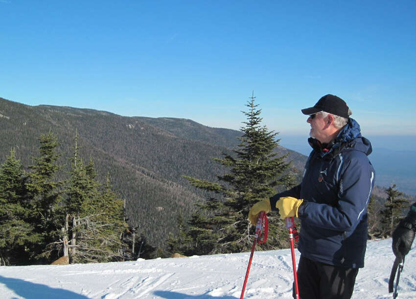 Whiteface snowsports school Director Aaron Dewey points out where the 1980s Olympic downhill started near the top of the mountain. (Rick Karlin/Times Union)