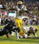 FILE - In this Saturday, Nov. 28, 2015, file photo, LSU running back Leonard Fournette (7) scores a touchdown during the second half of an NCAA college football game against Texas A&M in Baton Rouge, La. Fournette has been named to the AP All-America football team. (AP Photo/Jonathan Bachman, File)