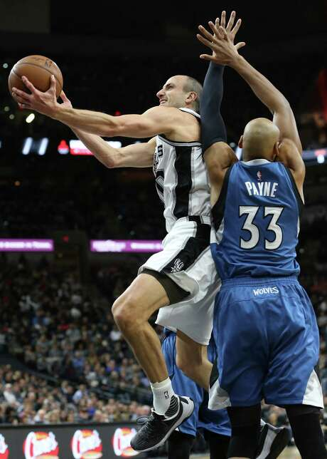 Manu Ginobili leans in for a shot against Andriene Payne as the Spurs host the Minnesota Timberwolves at the AT&T Center on December 28, 2015. Photo: TOM REEL, SAN ANTONIO EXPRESS-NEWS / 2015 SAN ANTONIO EXPRESS-NEWS