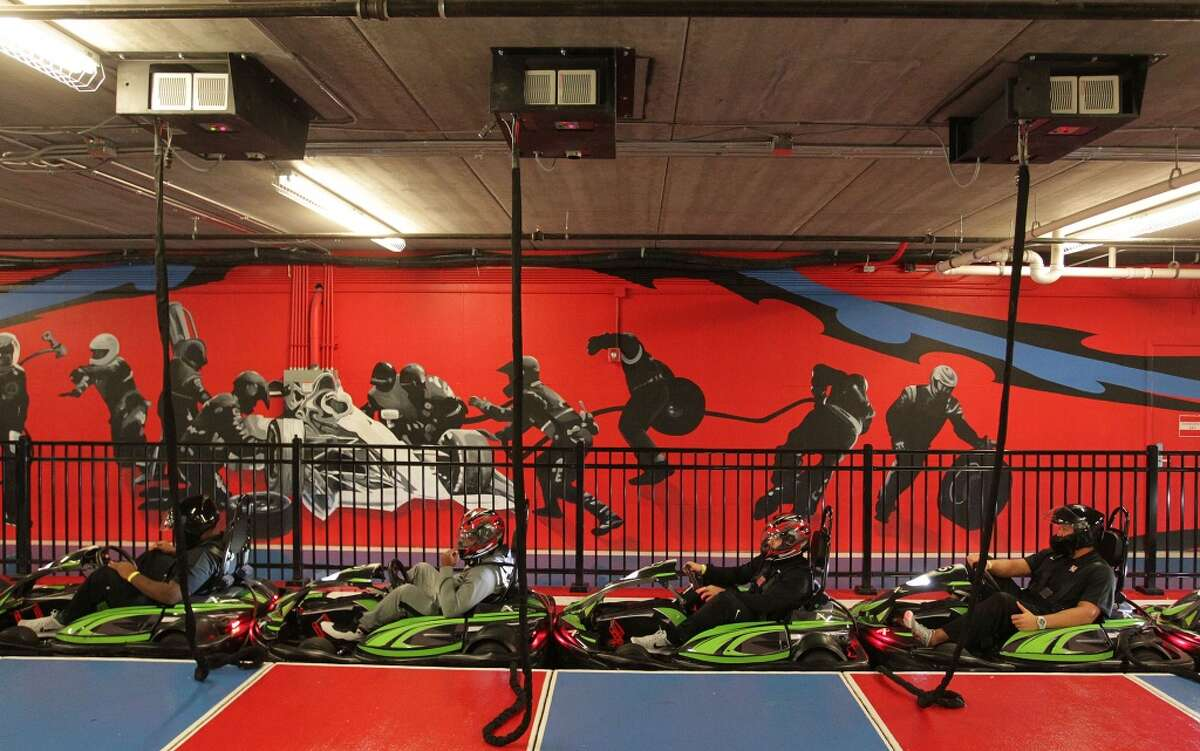 Members of University of Houston's football team get ready to race go carts at Andretti Indoor Karting and Games Monday, Dec. 28, 2015, in Marietta. ( Elizabeth Conley / Houston Chronicle )
