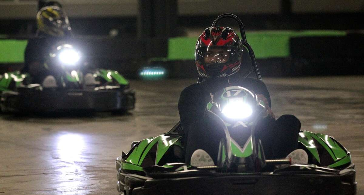 Members of University of Houston's football team race go carts at Andretti Indoor Karting and Games Monday, Dec. 28, 2015, in Marietta. ( Elizabeth Conley / Houston Chronicle )