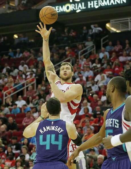 Rockets forward Donatas Motiejunas, shooting against Hornets center Frank Kaminsky, will likely see increased minutes in upcoming games. Photo: Thomas B. Shea, Freelance / © 2015Thomas B. Shea