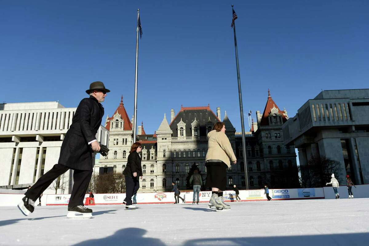 Skaters enjoy unseasonably warm weather as they circle around the ice rink on Wednesday, Dec. 16, 2015, at the Empire State Plaza in Albany, N.Y. (Cindy Schultz / Times Union)
