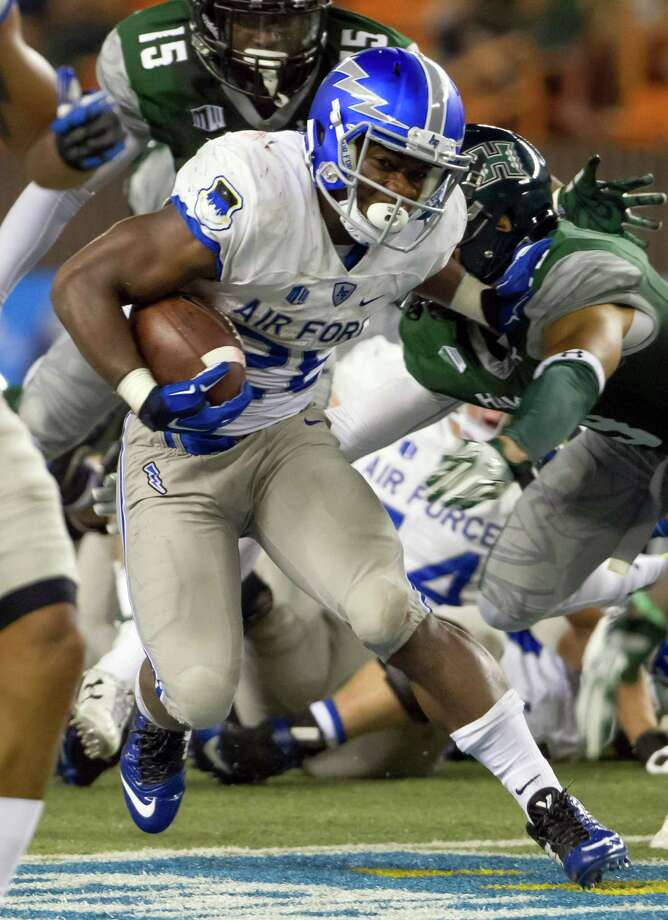 File- This Oct. 31, 2015, file photo shows Air Force running back Jacobi Owens (28) cutting back while running with the football in the third quarter of an NCAA college football game in Honolulu. (AP Photo/Eugene Tanner, File) Photo: Eugene Tanner / Associated Press / FR168001 AP