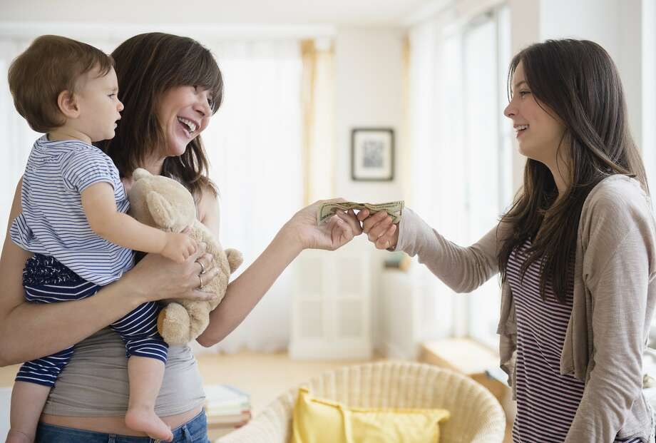 A mom is worried about a babysitter. Photo: Jamie Grill, Getty Images/Tetra Images RF