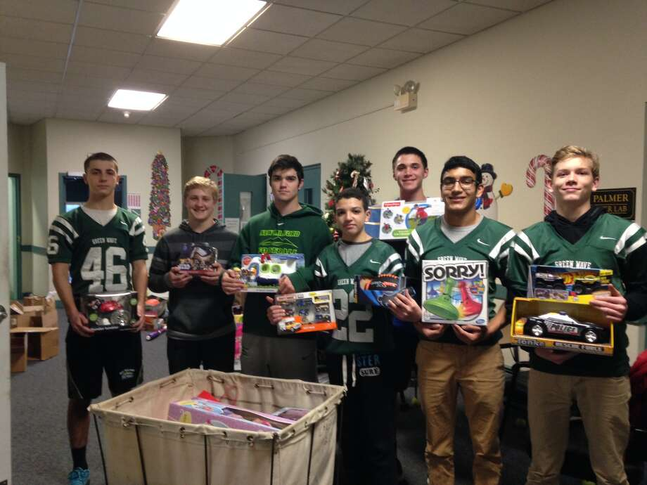 From left, Justin Hallas, Jack Manouse, Matthew Ryan, Jacob Anderson, Patrick Ryan, Dylan Jimenez and Kyle Wilton delivered an overflowing bin of toys to Social Services at the Richmond Center. Photo: Contributed Photo