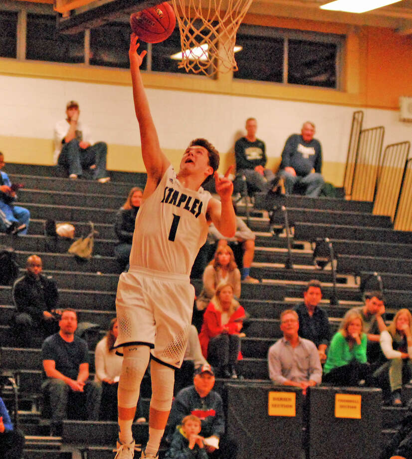 Staples' Justin Seideman goes for a layup during a boys basketball game against Darien in Trumbull, Connecticut on Tuesday, December 23rd, 2015. Photo: Ryan Lacey/Staff Photo / Westport News Contributed