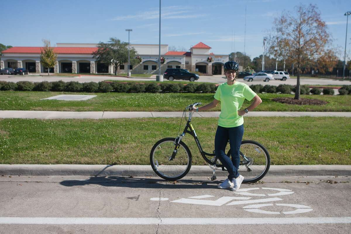 Missouri City recreation specialist Lindsay Valeri tries out one of the bikes available for rent at the city's recreation center at 2701 Cypress Point. Missouri City is seeking to promote cycling and develop a trail system.