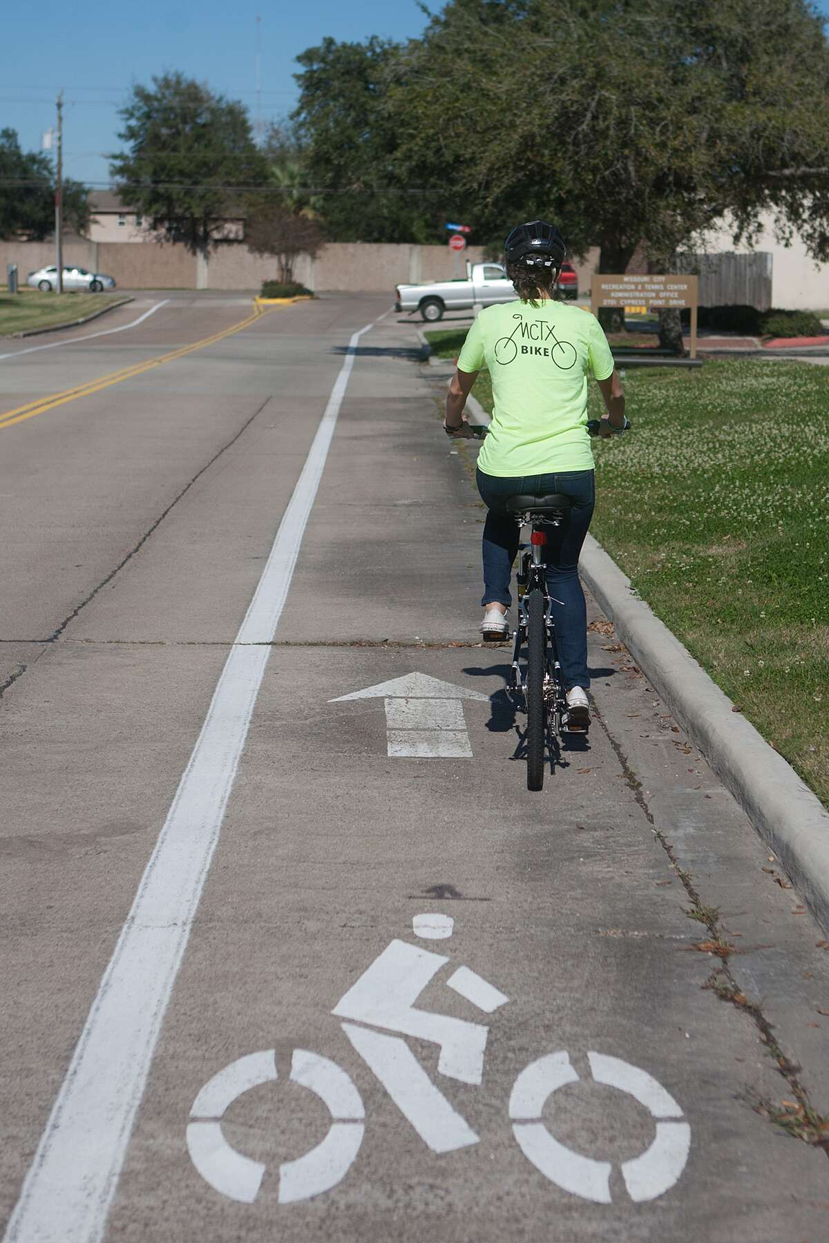 Lindsay Valeri an employee of Missouri City cycles on one of the city's marked bike routes.