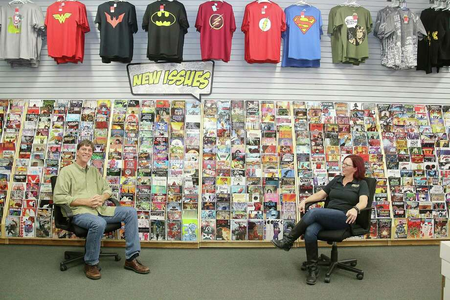 """Bedrock City Comic's Missouri City store manager LeAnn Sukman, shown with owner Richard Evans, says more women are interested in comics and more are working in the business of selling them. """"We're slowly taking over,"""" she says. Photo: Pin Lim, Freelance / Copyright Forest Photography, 2015."""
