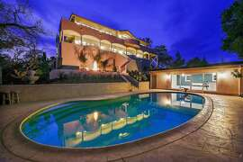 The Alamo home features five bedrooms, wraparound decks and a pool.