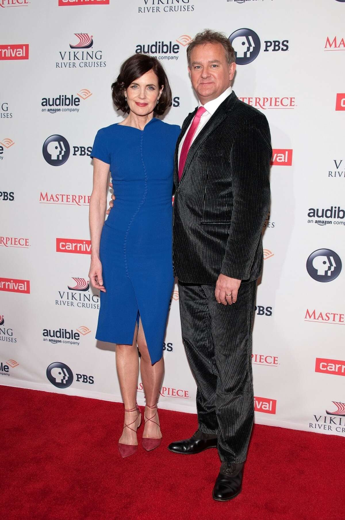 """Elizabeth McGovern (L) and Hugh Bonneville attend the """"Downton Abbey"""" series season six premiere at the Millenium Hotel on December 7, 2015 in New York City."""
