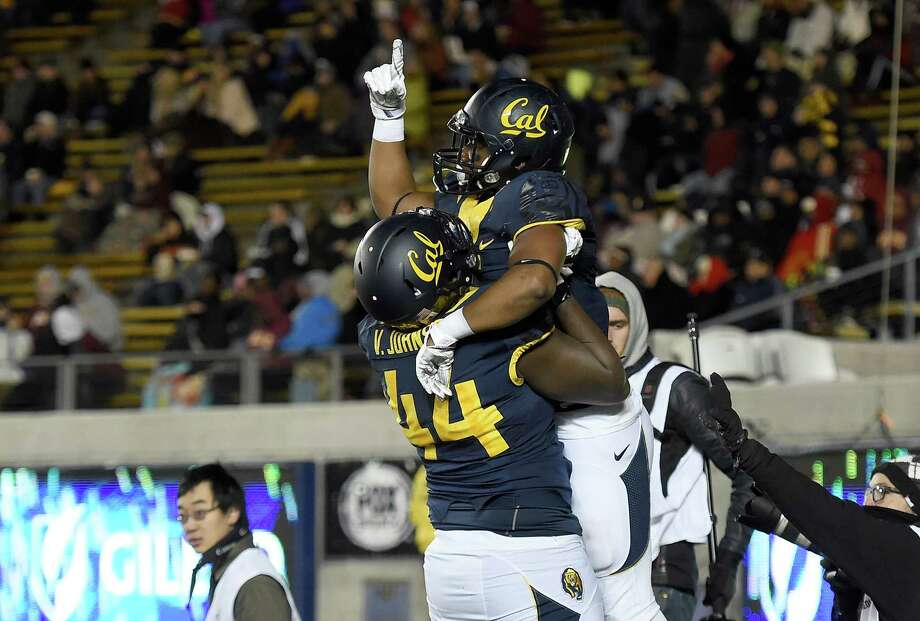 BERKELEY, CA - NOVEMBER 28:  Tre Watson #5 and Zeandae Johnson #44 of the California Golden Bears celebrates after Watson scored on a five yard touchdown run against the Arizona State Sun Devils during the second half of their NCAA football game at California Memorial Stadium on November 28, 2015 in Berkeley, California.  (Photo by Thearon W. Henderson/Getty Images) Photo: Thearon W. Henderson / Getty Images / 2015 Getty Images