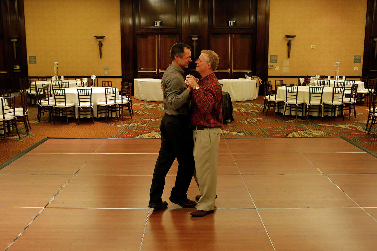 Mark Pharris, right, and Vic Holmes practice their first dance, which they learned over the course of several months at Arthur Murray Dance Studio, the night before their wedding in the ballroom of The Westin Stonebriar in Frisco on Friday, Nov. 11, 2015.