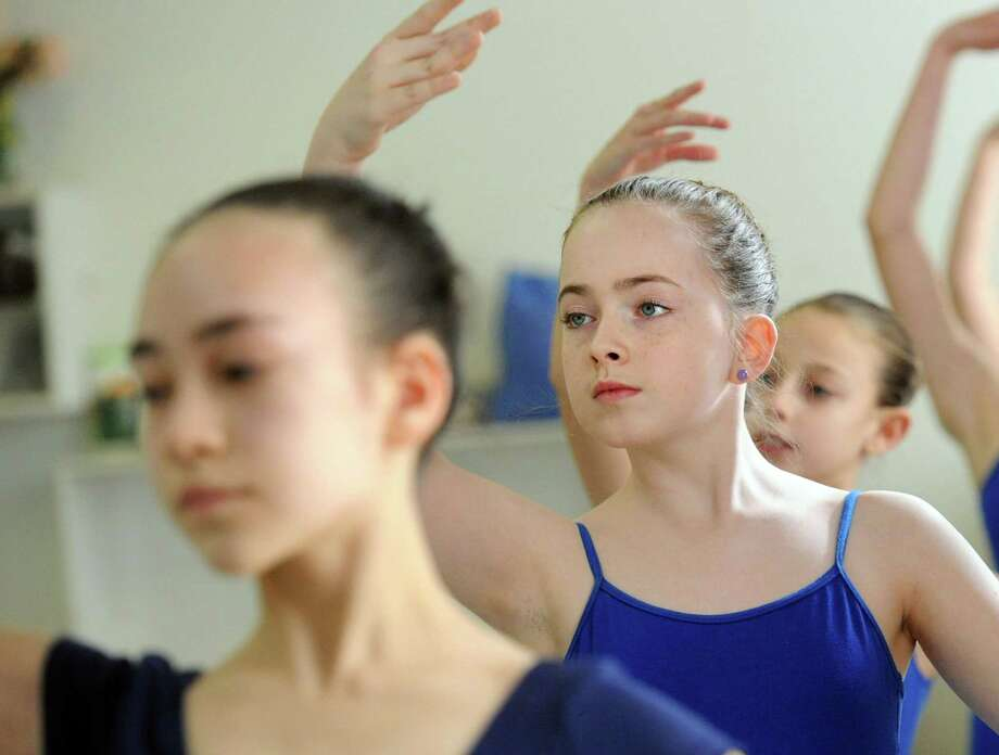 Darien ballerina Natalie Majd, 12, was the picture of poise as she polished up her plies at the Greenwich Ballet Academy in Port Chester, N.Y., in January. Photo: Bob Luckey / Staff Photo / Greenwich Time