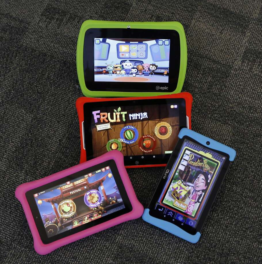 The LeapFog Epic (top), the Nabi Elev-8, the Amazon Fire Kids Edition (left) and Kurio's Xtreme 2. Photo: Kathy Willens, Associated Press