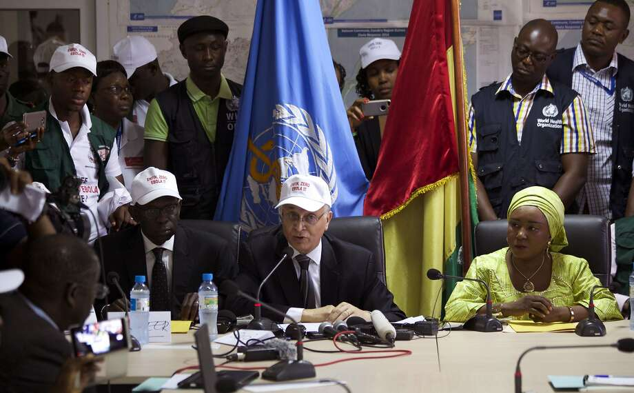 Mohamed Belhocine (center) of the World Health Organization speaks to reporters in Conakry. The U.N. says there have been no new known cases of Ebola in the world in the past 21 days. Photo: Youssouf Bah, Associated Press