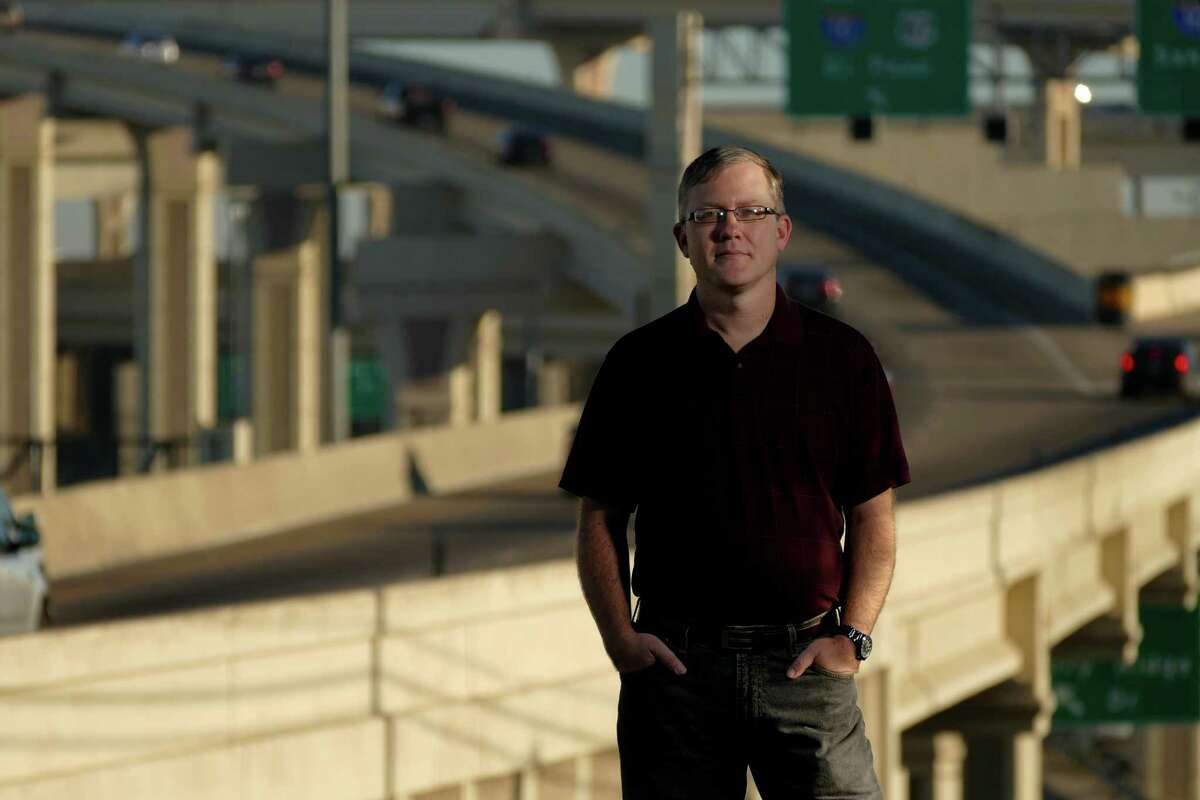 Brian Purcell, who started a website called the Texas Highwayman, keeps tabs on transportation of all kinds in San Antonio and the state. He stands at the Interstate 10 and Loop 410 interchange in San Antonio on Dec. 22.