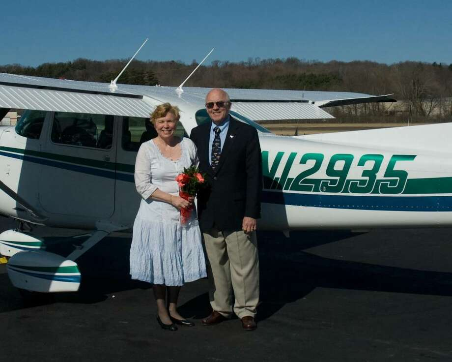Carol Froehlig and Bob Harris were married March 17, 2010, in their Cessna as they flew over Newtown. Photo: Contributed Photo / The News-Times Contributed