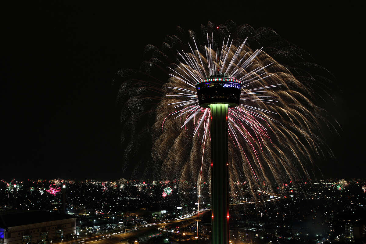Fireworks explode over Hemisfair Park and the Tower of the Americas in this view from the Alteza Residences at the start of Celebrate San Antonio fireworks display, Thursday, Jan. 1, 2015. A crowd of 70,000 was expected to attend the event that is considered the largest free New Year's celebration in Texas.