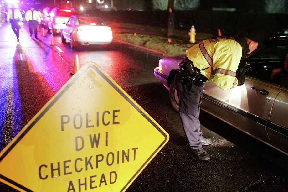 In this file photo, Greenwich Police officers stopped vehicles along West Putnam Ave. at a DUI checkpoint. Photo: David Ames / GT / 00005428A