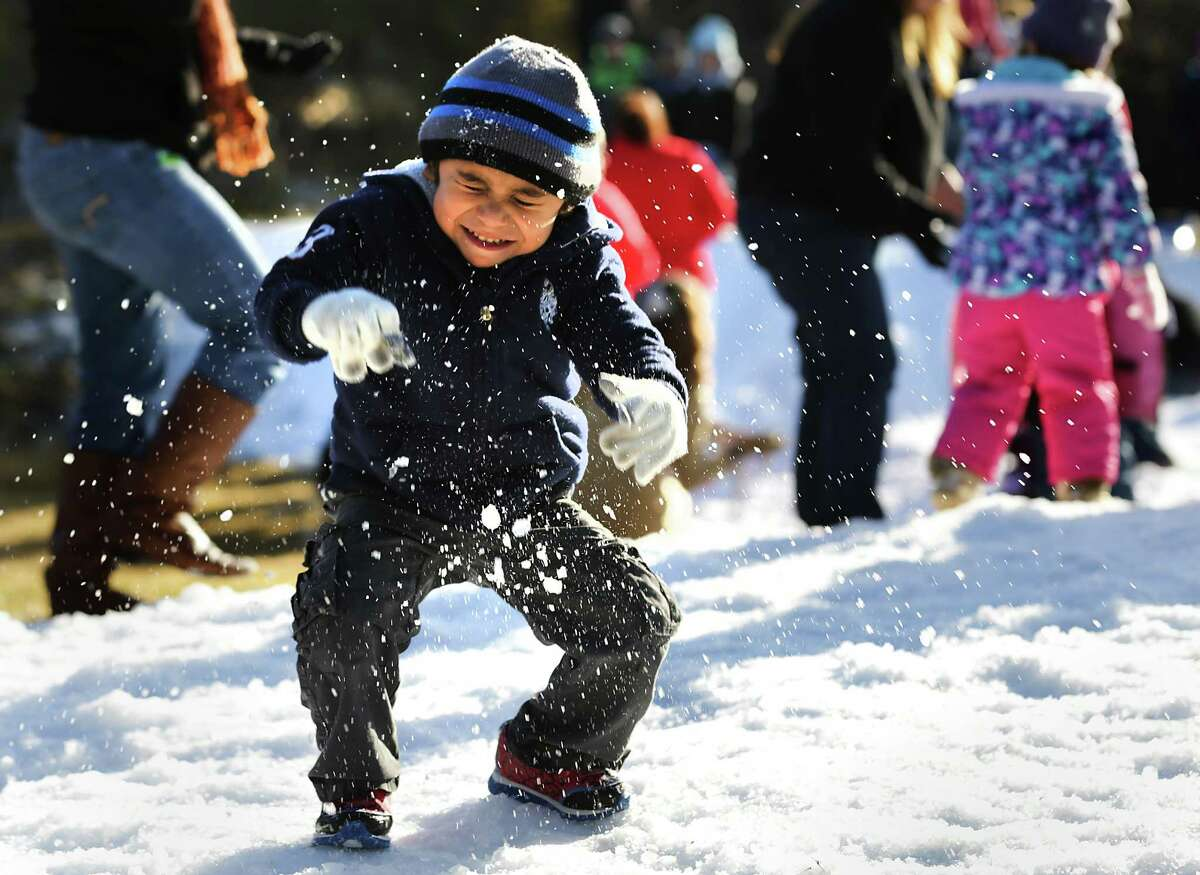 Eriq Gonzalez, 3, winces as he is hit with a snow ball from a fellow preschool student. Students at Sunshine Cottage had a Snow Day with more than 12,000 lbs. of snow (shaved ice from Pure Party Ice) blown in. The kids enjoyed northern winter activities like sledding, making snow angels, snowball throwing all capped off with marshmellows, s'mores, and hot chocolate. Friday, Jan. 16, 2015.