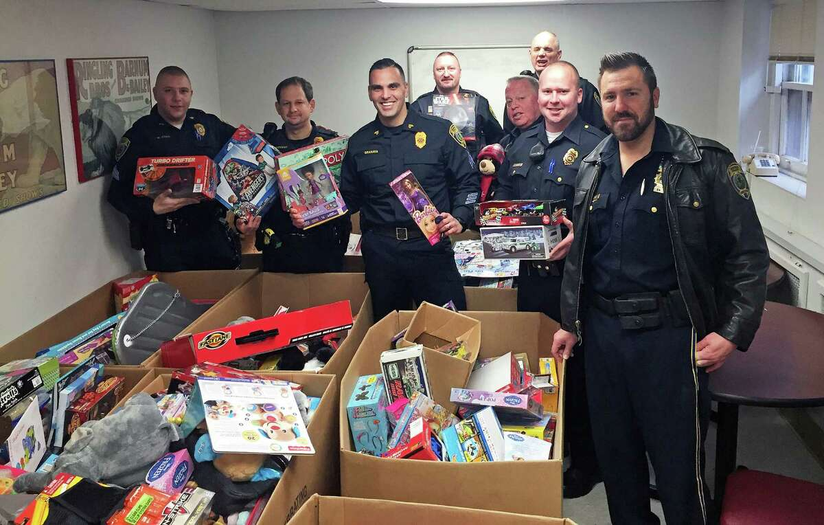 Fairfield police officers show off some of the toy's collected in the Police Benevolent Association's annual holiday toy drive. Fairfield Police Department Toy Drive Now - Dec. 18 Drop-off location: Police Headquarters, 100 Reef Road, Fairfield Find out more
