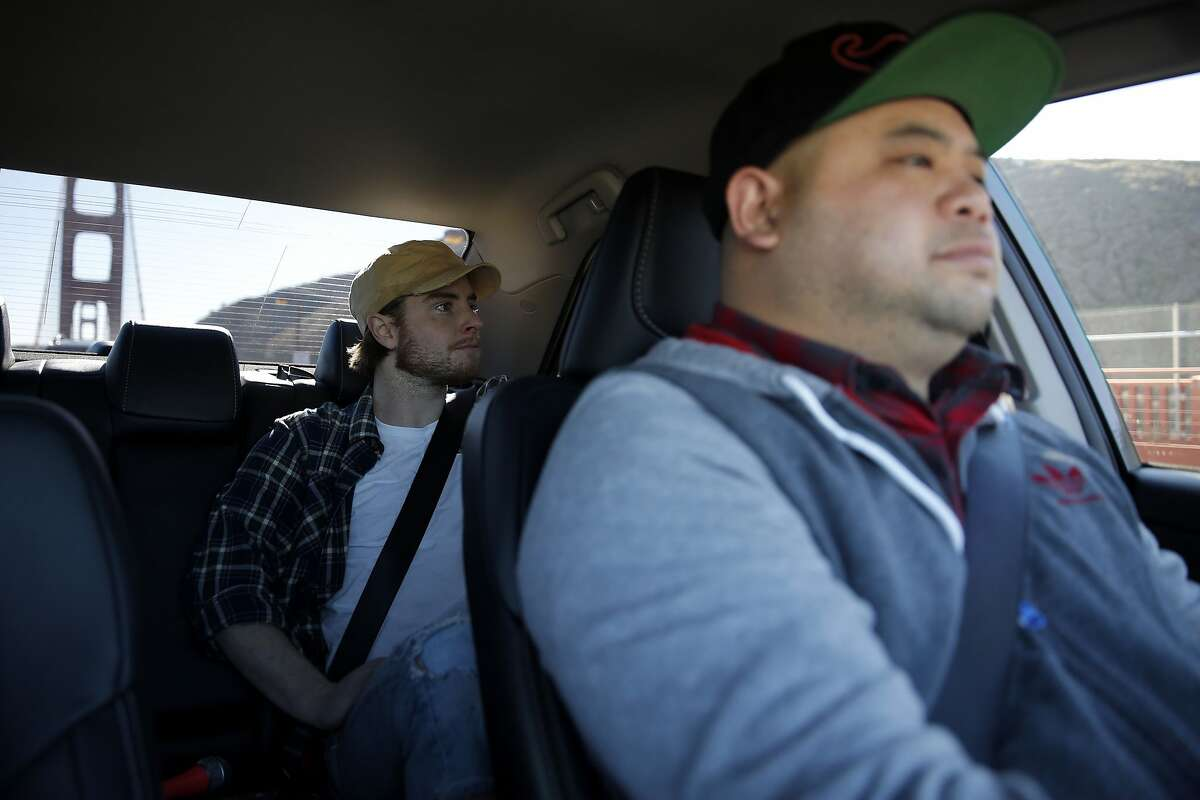 Lyft driver Carlo Garibay (right) gives Dylan Hull a ride into Marin County, California, on Tuesday, Dec. 29, 2015.