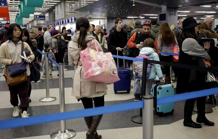 Airlines are shifting the timing of thousands of flights, even adding dozens of red eyes, as they try to avoid delays while hauling millions of passengers through the holidays. Photo: Nam Y. Huh, Associated Press