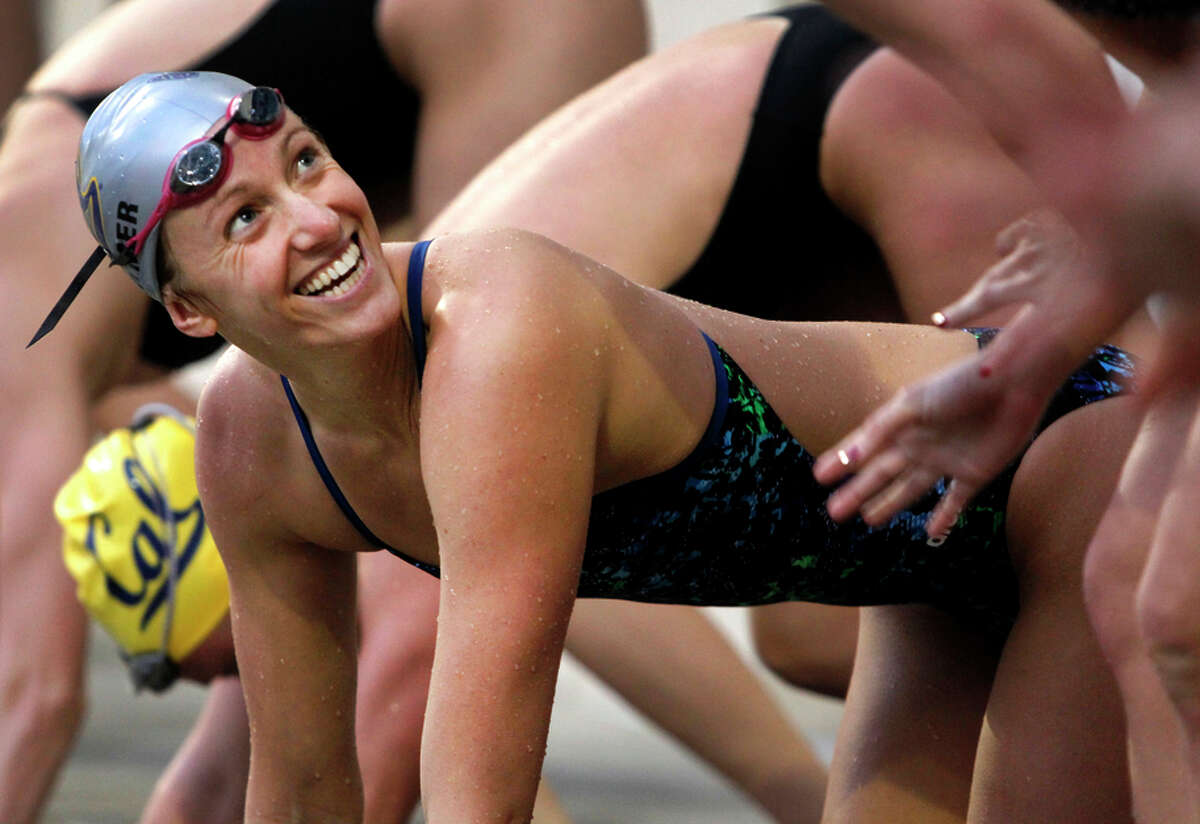 Gold-medal swimmer Dana Vollmer laughs with fellow Olympian Rachel Boostma during a training session at Cal.