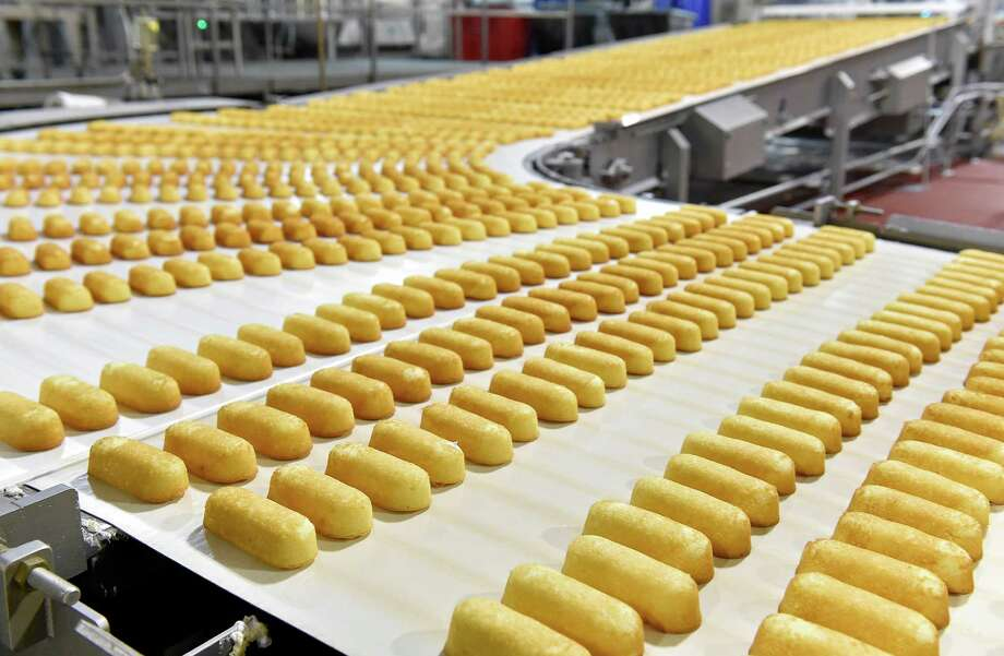 Freshly baked Twinkies move down the conveyor belt to the packaging area at the Hostess plant in Emporia, Mo., earlier this month. Photo: Jill Toyoshiba, MBR / Kansas City Star