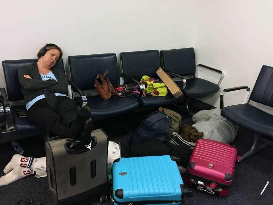 The Garofoli family rest while stranded at Bush International Airport in Houston.