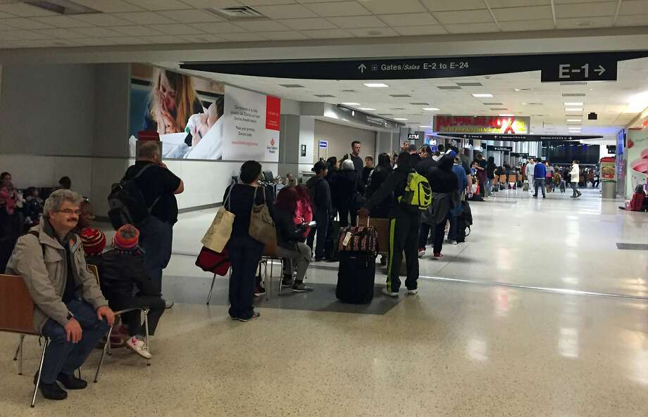 Line in United terminal Monday in Houston.