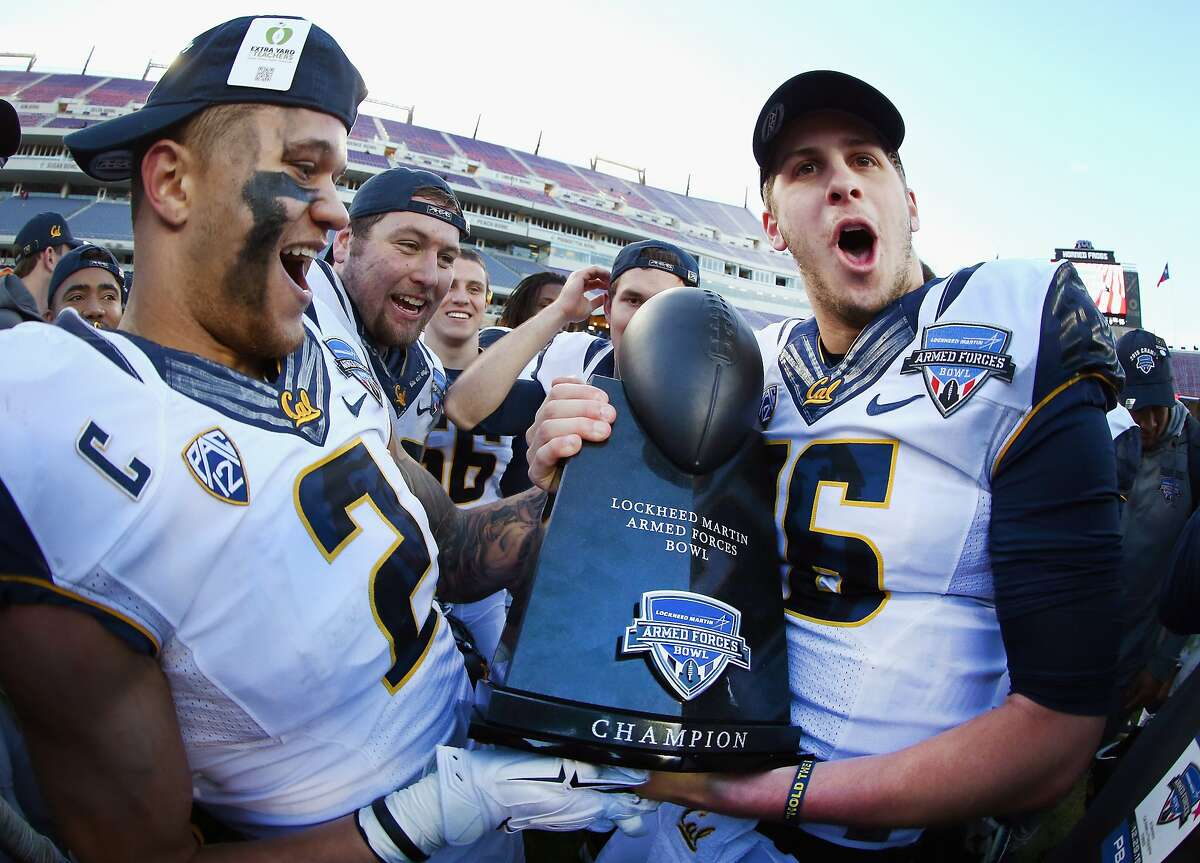 FORT WORTH, TX - DECEMBER 29: Daniel Lasco #2 of the California Golden Bears and Jared Goff #16 of the California Golden Bears celebrate with the championship trophy after beating the Air Force Falcons 55-36 in the Lockheed Martin Armed Forces Bowl at Amon G. Carter Stadium on December 29, 2015 in Fort Worth, Texas. (Photo by Tom Pennington/Getty Images)