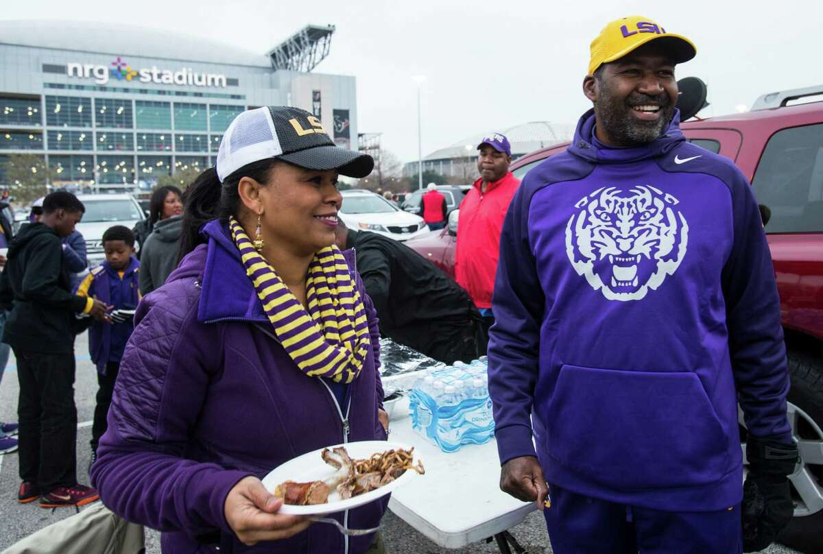 College football fans tailgate before the AdvoCare V100 Texas Bowl between LSU and Texas Tech at NRG Stadium on Tuesday, Dec. 29, 2015, in Houston.