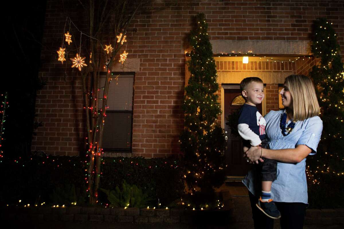 Kallie Benes stands in front of her home in Shady Acres with her son Drew Benes, 2. Benes and her husband moved to Shady Acres in 2009. Wednesday, Dec. 16, 2015. ( Marie D. De Jesus / Houston Chronicle )