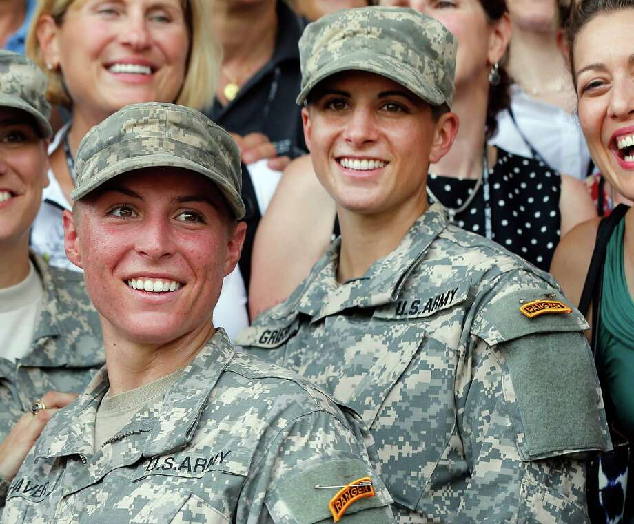 FILE - In this Aug. 21, 2015, file photo, U.S. Army First Lt. Shaye Haver, center, and Capt. Kristen Griest, right, pose for photos with other female West Point alumni after an Army Ranger school graduation ceremony at Fort Benning, Ga. Haver and Griest became the first female graduates of the Army's rigorous Ranger School. Their history-making is among the state's top stories of 2015. (AP Photo/John Bazemore, File) Photo: John Bazemore, STF / AP