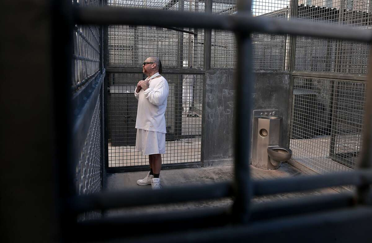Robert Galvan in prison for a double murder in 1996 gets 3 hours outside a day in a secure cell for exercises at the Adjustment Center of death row at San Quentin State Prison on Tuesday December 29, 2015, in San Quentin, Calif.