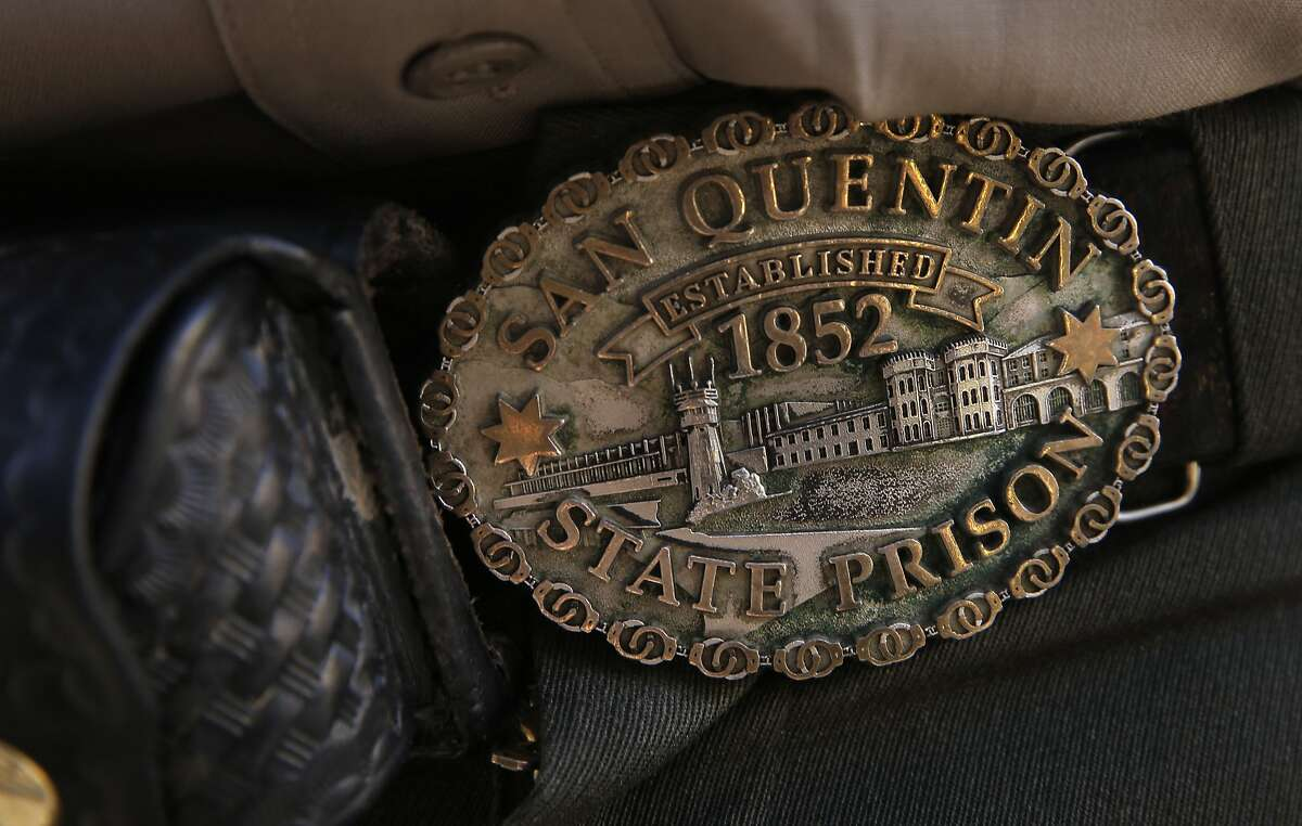 The Belt buckle of Officer Marc Wood during a tour of death row at San Quentin State Prison on Tuesday December 29, 2015, in San Quentin, Calif.