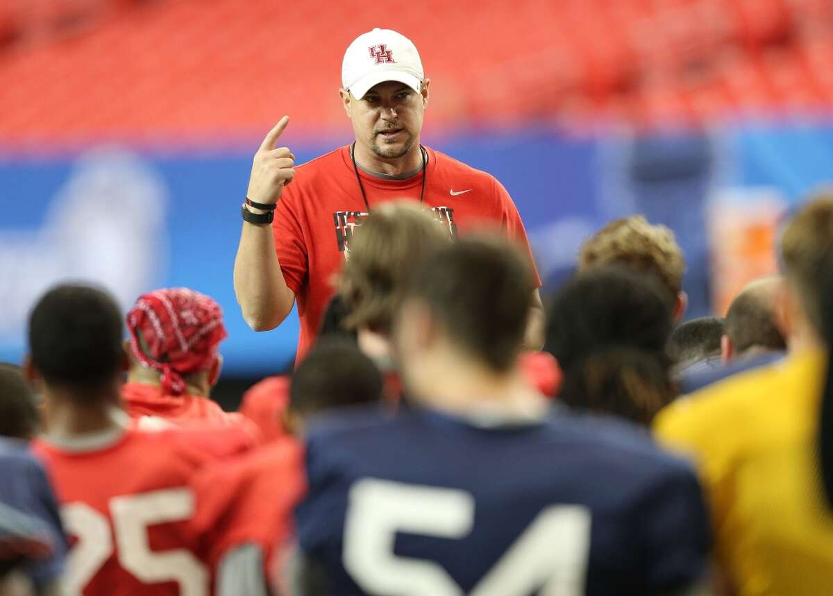 Houston Cougars head coach Tom Herman talks to his team before practice at the Georgia Dome on Tuesday, December 29, 2015. University of Houston Cougars football team practice at the Georgia Dome on Tuesday, Dec. 29, 2015, in Houston. ( Elizabeth Conley / Houston Chronicle )