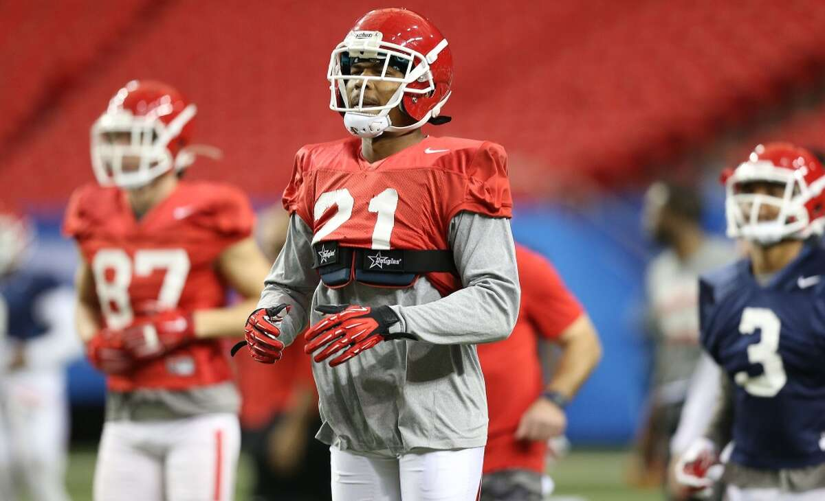 Houston Cougars wide receiver Chance Allen (21) warms up before practice at the Georgia Dome on Tuesday, December 29, 2015. University of Houston Cougars football team practice at the Georgia Dome on Tuesday, Dec. 29, 2015, in Houston. ( Elizabeth Conley / Houston Chronicle )