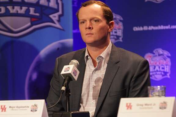 Houston Cougars offensive coach Major Applewhite talks to the media during a morning press conference in Atlanta on Tuesday, Dec. 29, 2015. ( Elizabeth Conley / Houston Chronicle )